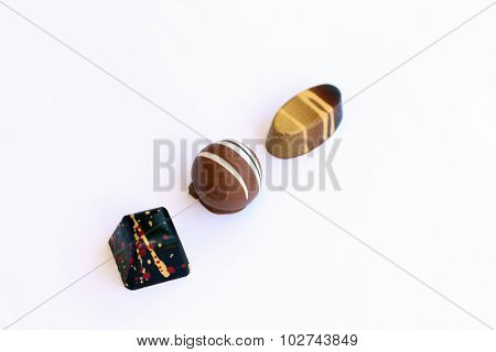 Round chocolate bonbon with squared anad oval on her sides
