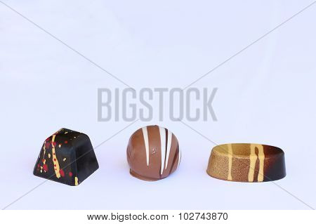 Squered, round and oval chocolate bonbon