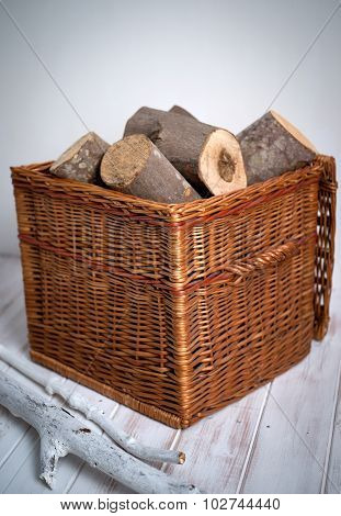 Logs In Wicker Basket
