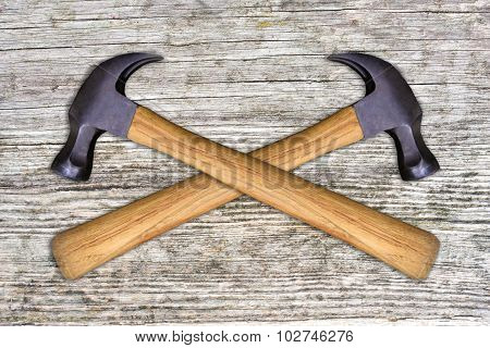2 Hammers on a wooden background