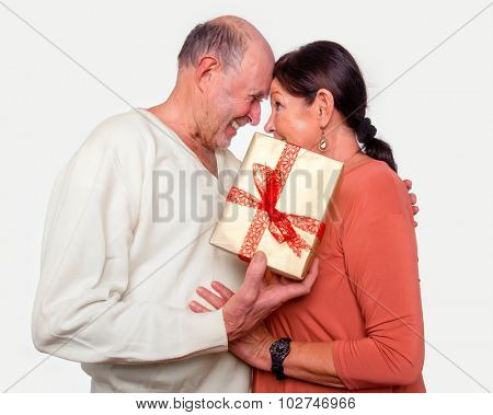 senior couple with gift happy