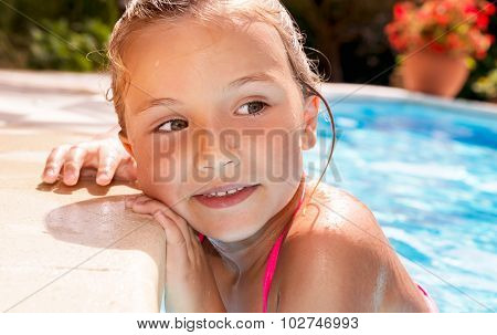 little girl on the swimming-pool