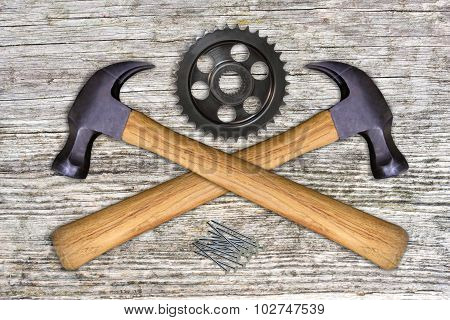 2 hammers, gear wheel and iron nails