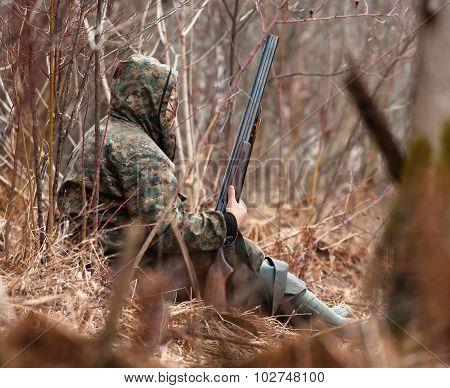 Hunter Hidden In Shrubs