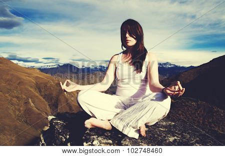 Woman Sitting Medidating Mountain Range Concept
