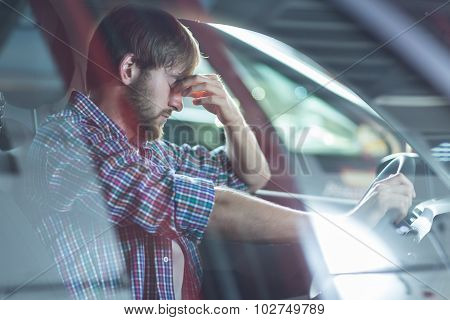 Worried Driver In His Car