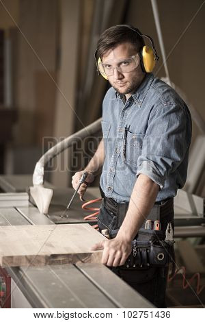 Worker In Earmuffs And Goggles