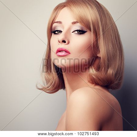 Beautiful Elegant Makeup Woman With Blond Short Hairstyle. Toned Closeup Portrait