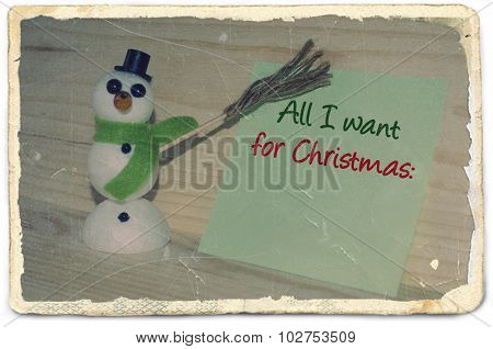 Old photo paper with message All I want for Christmas