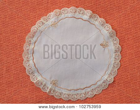 white mat crotch doilie isolated over red background