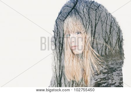 young blonde woman double exposure with winter wood scene
