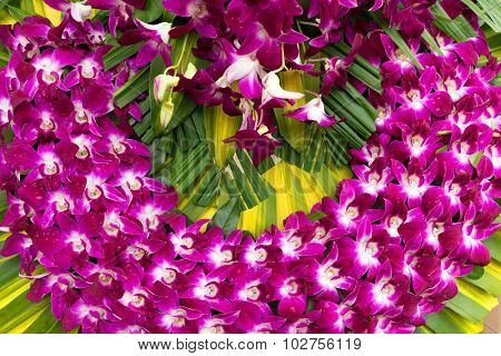 Traditional Vietnamese orchid flower religious wreath in a Saigon market.