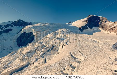 Panorama of mountain glacier at sunset.