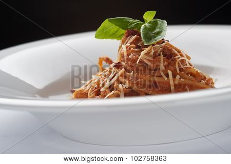 Spaghetti Bolognese with Basil Leaf and parmesan