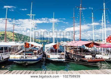 Sailing boats on port of Angra dos Reis city in state of Rio de Janeiro. Brazil.