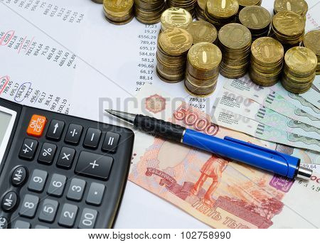 coins, ruble banknotes and calculator