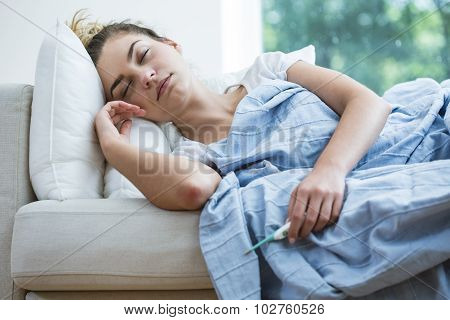 Feverish Woman Lying Under Blanket