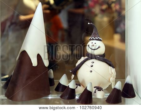 Snowman And A Cone Of White And Dark Chocolate