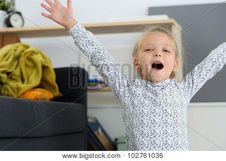 Smiling Blonde Little Girl Raised Up Hands