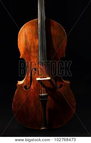 Vintage cello on dark background