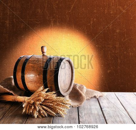 Beer barrel on table on brown background