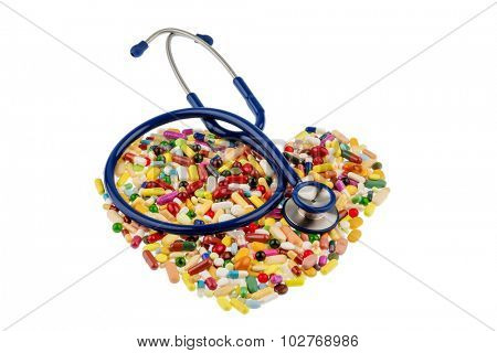 stethoscope and pills in heart shaped arrangement, symbol photo of heart disease, diagnosis and medication