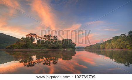Pink Cloud Sunset with River Landscape.