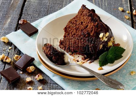 Chocolate Cake With Icing On A Plate With A Piece Of