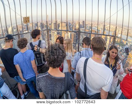 NEW YORK,USA - AUGUST 15,2015 : Tourists at the Observation deck on the Empire State Building in New York City