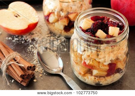 Overnight oats with apples and cranberries in a mason jar