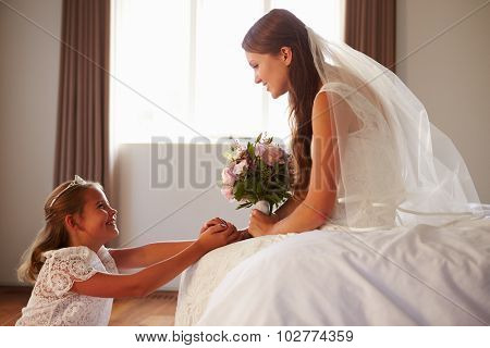 Beautiful Bride With Bridesmaid In Bedroom