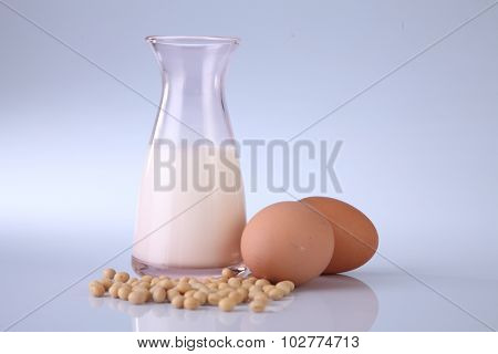 soy bean and bottle of soy milk and egg on the white background