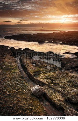 Seascape of the Portuguese coastline at sunset light