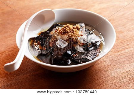 Grass Jelly Dessert  In Syrup With Ice And Brown Sugar.
