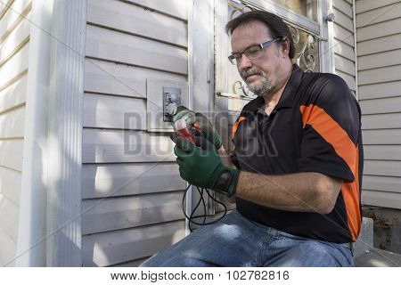 Electrician Checking Outside Outlet For Customer