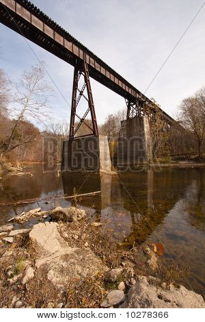 Old Railroad Bridge Over A Creek Vertical