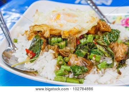 Steamed Rice Topped With Stir-fried Crisp Pork , Basil And Over Hard Fried Egg