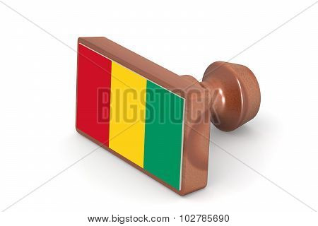 Wooden Stamp With Guinea Flag