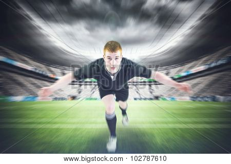 Rugby player tackling the opponent against rugby stadium