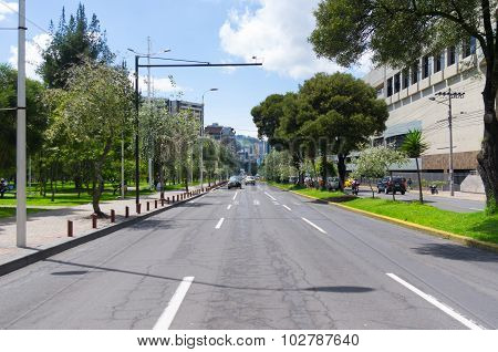 Great image from modern part of Quito mixing new architecture with charming streets and green sourro