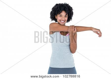 Portrait of cheerful woman exercising against white background