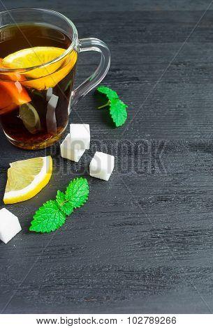 A Cup Of Black Tea, Lemon Slices, Mint