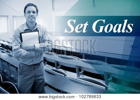 The word set goals against male teacher with notepad in the lecture hall