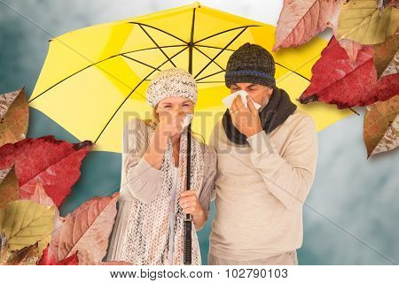 Couple sneezing in tissue while standing under umbrella against low angle view of sky
