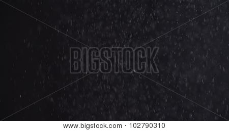 abstract particles flying over black background