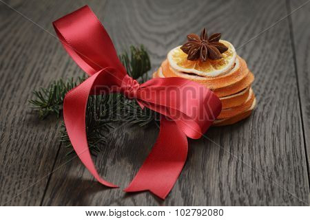 spruce twig with red bow and orange slice, christmas