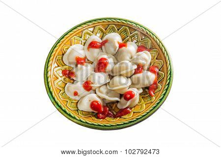 Full Ketchup Pelmeni On A White Background