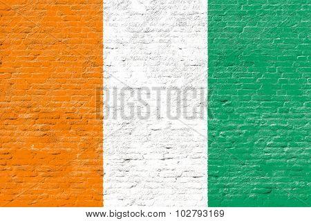 Ivory Coast - National flag on Brick wall