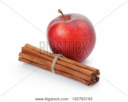 red apple with cinnamon sticks, isolated on white
