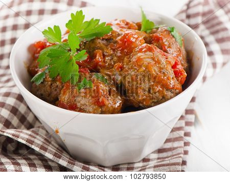 Meatballs With Tomatoes And Fresh Parsley.